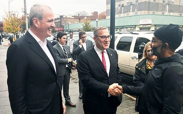 New Jersey Governor Phil Murphy, left, and Michael Wildes campaign in Englewood on Election Day. (Photo provided)