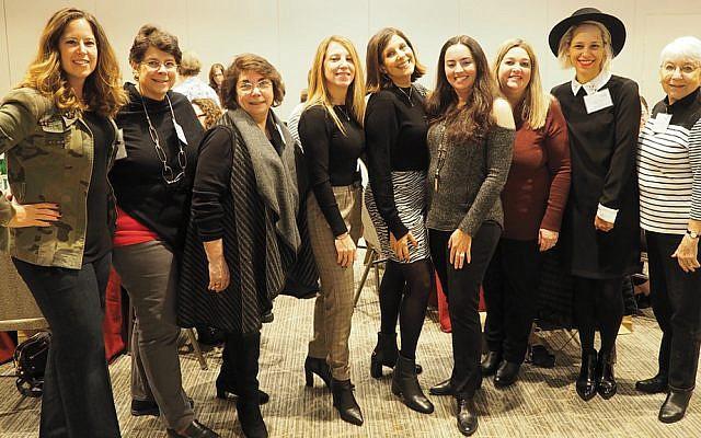 Temple Sinai's sisterhood executive board, from left, Hilary Baris, Hilary Eth, Ruth Seitelman, Lauren Kluger, board president Franci Steinberg, Sari Hollender, Jessica Hirsh, Noah Smalley, and Anne Fleisher. (Photos courtesy Temple Sinai)