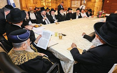 Ashkenazi Chief Rabbi David Lau, second from left; Sephardi Chief Rabbi Yitzhak Yosef, third from left; and Rabbi Yisrael Meir Lau at a special meeting of the Israeli Rabbinate Council at the Western Wall tunnels in Jerusalem's Old City on May 24, 2017. (Shlomi Cohen/Flash90)
