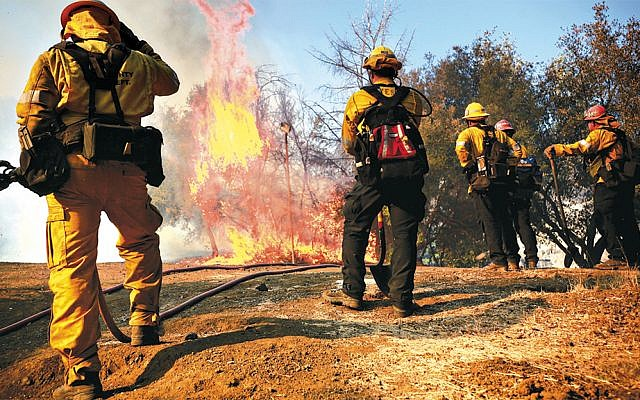 Firefighters battle a blaze at the Salvation Army Camp in Malibu, Calif., November 10, 2018. (Sandy Huffaker/Getty Images)