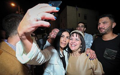 Aliza Bloch, right, celebrates with supporters after being elected mayor of Beit Shemesh as election results were announced on November 1. (Yaakov Lederman/Flash90)