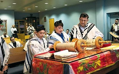 Lior Barron, second from left, and Phillip Nussbaum, third from left, celebrate their recent bar mitzvah at Zichron Yisrael. (Zichron Yisrael)