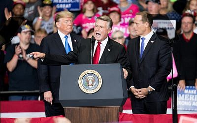 Mark Harris, center, addresses the crowd as President Donald Trump, left, and Republican Congressional candidate for North Carolina's 13th district Ted Budd, right, listen at the Bojangles Coliseum in Charlotte, N.C., Oct. 26, 2018. (Sean Rayford/Getty Images)