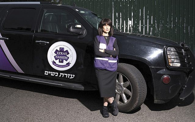 Judge Ruchie Freier leans against an emergency response vehicle of Ezras Nashim, the all-female ambulance corps she helped establish in Brooklyn. (Courtesy 93Queen)