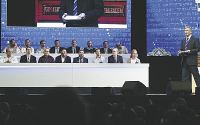 Finalists in the International Bible Contest Champion of Champions onstage at the Jerusalem Convention Center on December 6. Rabbi Ezra Frazer is second from right in the top row; Yair Shahak is second from left in the bottom row. (Shlomi Cohen/FLASH90)