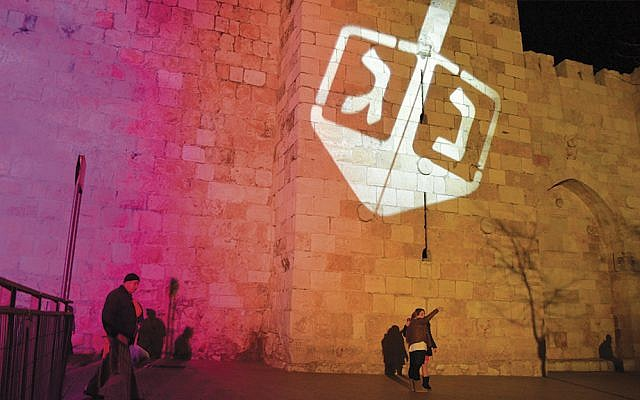 A dreidel is projected on the walls of Jerusalem's Old City in a nightly light show. (© Daniel Santacruz)