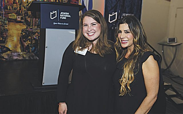 Alyson Chananie, left, a Power of Women event ambassador, with speaker Siggy Flicker. (Perry Bindelglass Photography)