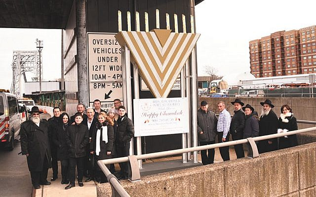 Ken Sagrestano, the GWB's general manager, joins Chanukah ceremonies with the German and Gutkin families, who sponsored the bridge's menorahs, and Rabbi Mordechai and Shterney Kanelsky of Bris Avrohom. (Courtesy Bris Avrohom)