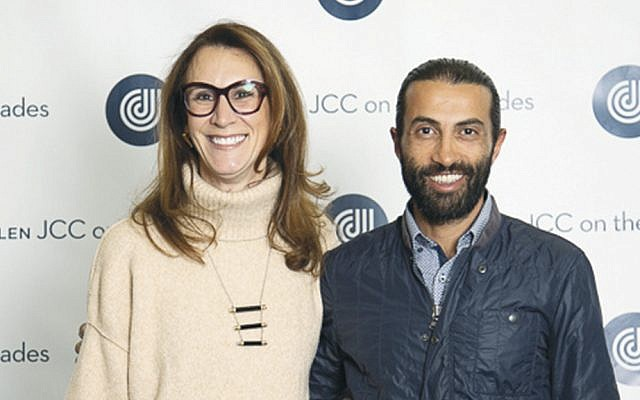 JCC board chair Jodi Scherl, left, with Mosab Hassan Yousef at the VIP reception. (Courtesy JCCOTP)