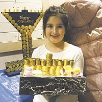 "Emma Katz with her ""Squishy Menorah,"" above, and the Kandy family's ""Scooter Menorah"" were the winners in Lubavitch on the Palisades' menorah contest at its Chanukah Family Festival. Music, donuts, arts and crafts, and a menorah lighting were featured. (Courtesy LOTP)"