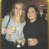 "Stephanie Shore and Jennifer Seligman at ""Latkes and Vodkas,"" an adult Chanukah celebration at Temple Beth Tikvah in Wayne. (Courtesy TBT)"
