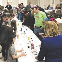 Shomrei Torah in Wayne held a Chanukah program that included a menorah-making family workshop. (Courtesy Shomrei Torah)