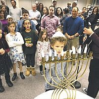 "Temple Emanuel of the Pascack Valley celebrated ""Havdalah and Chanukah"" on Saturday evening, December 8, the seventh night of Chanukah, led by Matty Roxx. A latka party and dinner followed.  (Photo provided)"