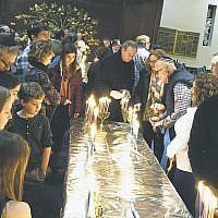 "Temple Beth El of Northern Valley in Closter held its 22nd annual ""101 Menorahs"" multigenerational Shabbat. Families brought their own menorahs and candles to celebrate the sixth night of Chanukah. An oneg with latkes and donuts followed. (Courtesy TBENV)"
