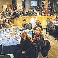On the eighth night of Chanukah, Temple Beth Sholom in Fair Lawn held its annual ad journal dinner dance celebrating Israel's 70th anniversary. Rabbi Alberto Zeilicovich and Cantor Andrew Schultz led the chanting of the blessings while people at each table lit a chanukiah. (Courtesy Temple Beth Sholom)
