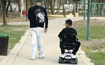"""People with a range of disabilities and their friend enjoyed handicap-accessible amenities at Ilanot Forest in central Israel as part of """"International Day of Persons with Disabilities"""" on Decemmber 3, 2018. (Diego Mitleberg/KKL-JNF)"""