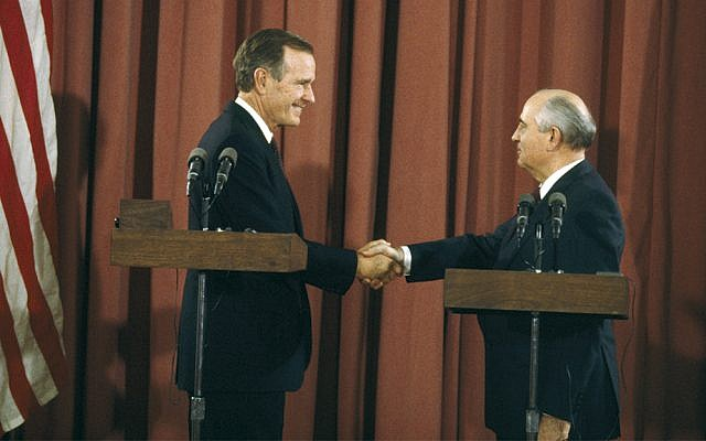 President George Bush and Soviet President Mikhail Gorbachev shake hands during a summit held before the start of the 1991 Madrid Peace Conference.  (Pascal Le Segretain/Sygma via Getty Images)