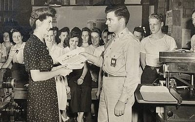 Jeanette Kern, left, receives one of the two commendations she received for her work during World War II as a clerk in the Army Signal Corps on July 27, 1944. (Photos Courtesy of Oren Hayon)