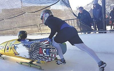 Dave Nicholls pilots the bobsled as Chaim Raice pushes. (Courtesy of Nicholls)