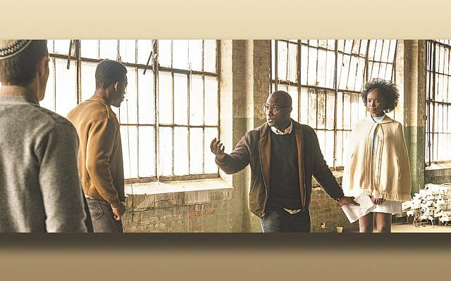 "Barry Jenkins, right, directing Stephan James, center, and Dave Franco on the set of ""If Beale Street Could Talk."" (Annapurna Pictures)"