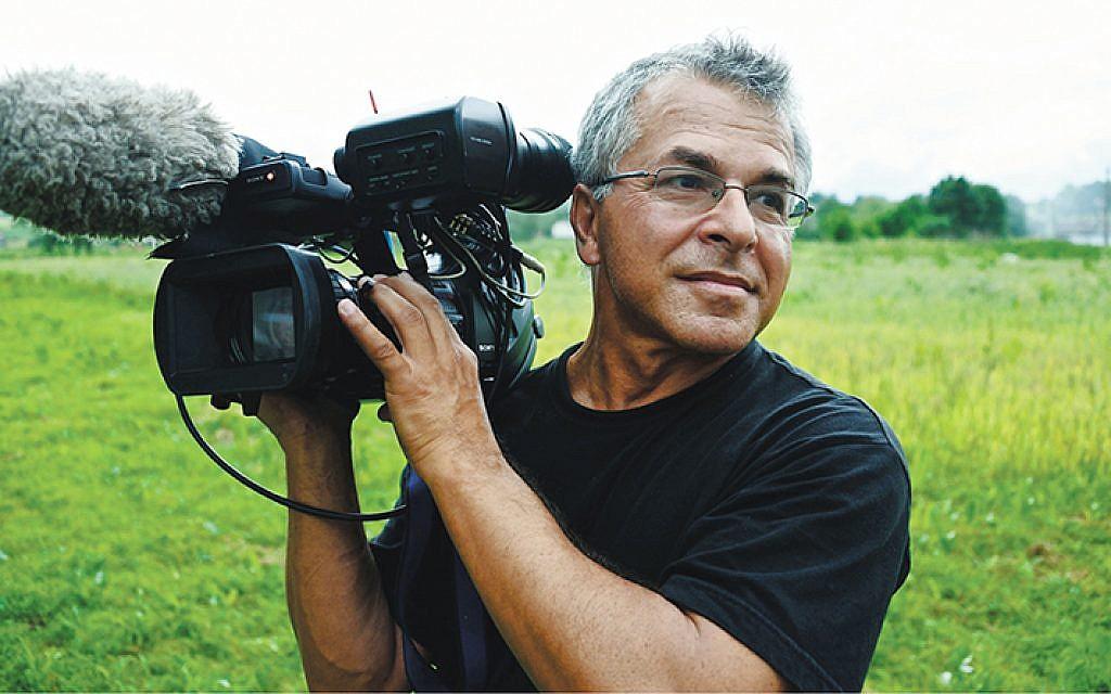 """Slawomir Grunberg filming """"Szymon's Return"""" in Ukraine."""