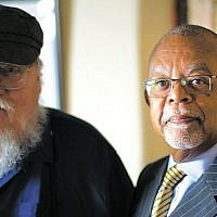 "George R.R. Martin, left, shown with ""Finding Your Roots"" host Henry Gates, Jr., was shocked by his DNA test. (Courtesy of McGee Media/Ark Media)"