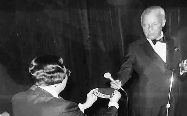 Sonny Schwartz, one of the organizers of a 1981 fundraiser for the Hebrew Academy of Atlantic County, N.J., presents Frank Sinatra with a personalized yarmulke at the event, held in a kosher hotel in Atlantic City. (Courtesy of Pauline Schwartz)