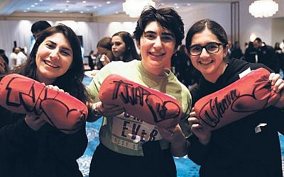 Linit, center, Stephanie, right, and a friend stand together at the convention. (Etan  Vann/NCSY)