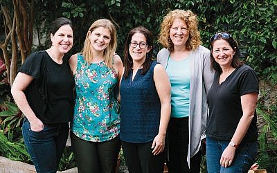 These five rabbis — from left, Aderet Drucker, Jill Perlman, Rachel Kahn-Troster, Barbara Penzner, and Jessica Graf — all are AJWS global justice fellows. (Photos by Christine Han Photography)