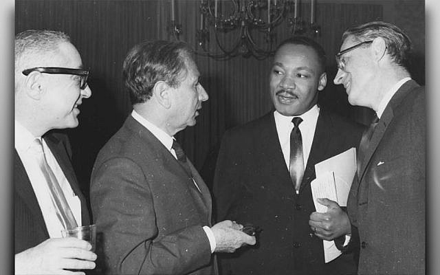 Rabbi Joachim Prinz, second from left, confers with Martin Luther King Jr. at an American Jewish Congress fundraising event. (American Jewish Congress)