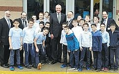 Students and faculty members at Yeshiva Beis Hillel pose with Governor Phil Murphy.