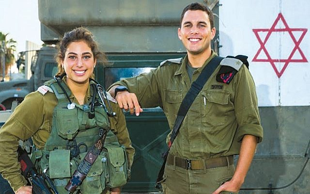 In July 2018, Staff Sgt. Hilla (left) saved the life of Maj. Yehuda (right) after he was struck in the chest by shrapnel during conflicts along the Gaza border. (Courtesy IDF)