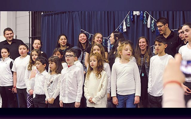 """The GBDS choir and Binghamton's Kaskeset group sing """"Hatikvah"""" together. Hannah Greenwald, a GBDS alumna, is in the back row, second from right. (Sandra Alpern)"""