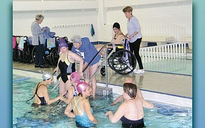 "NCJW volunteers work with swimmers at ""Swim-In,"" a unique aquatherapy program for people with multiple sclerosis. More volunteers are needed to help the swimmers both in and out of the pool. (NCJW)"