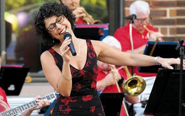 Singer Tanya Garzia with the Reflections Jazz and Swing Orchestra. (Courtesy Beth AM Temple)