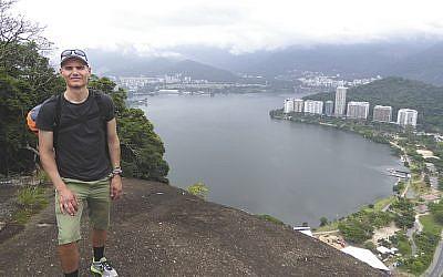 Joel stands on a hill overlooking Rio de Janeiro.
