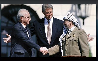 President Bill Clinton presides at the White House lawn ceremony marking the signing of the Oslo Agreement by Israeli President Yitzhak Rabin, left, and PLO chairman Yasser Arafat on September 13, 1993.