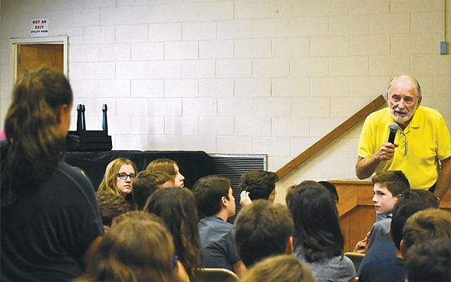 Paul Galan, president of the Holocaust Museum & Center for Tolerance and Education based at Rockland Community College, speaks to children in a local school.