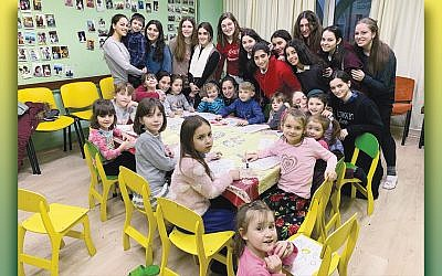 Students from Ateres Bais Yaakov Rockland in Hempstead, N.Y., pose with their charges at the orphanage run by Tikva in Odessa, Ukraine.