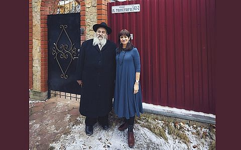 Rabbi Mordechai and Shterney Kanelsky stand in front of the family house in Malachovka, outside Moscow.