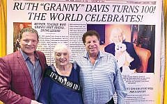 Ruth Davis celebrates turning 100; she is flanked by her son Sam Davis, left, and Sam's law partner, Garry Salomon. The two were Hebrew school classmates at the Bergenfield Dumont JCC.
