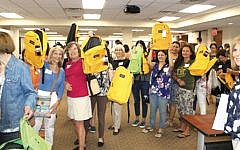 Federation volunteers pack backpacks for supplies for success program.