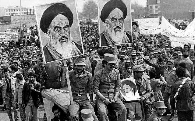 Iranian Islamic Republic Army soldiers carry posters of the Ayatollah Khomeini during the revolution of 1979. (Keystone/Getty Images)