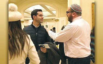Rabbi Beni Wajnberg greets a Shabbat Kulanu participant at Temple Beth Rishon.