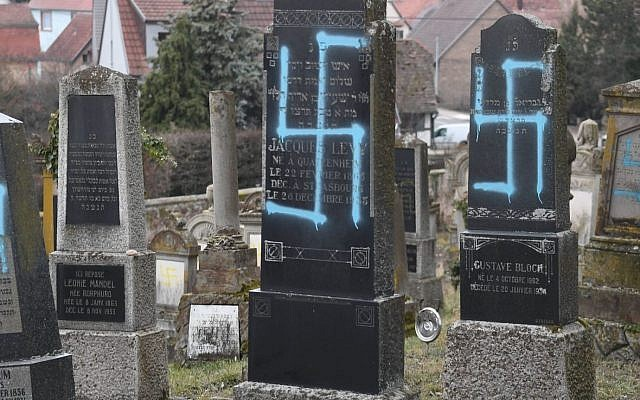 Some of the 80 gravestones vandalized in a Jewish cemetery in the eastern French village of Quatzenheim, Feb. 19, 2019. (Frederick Florin/AFP/Getty Images)