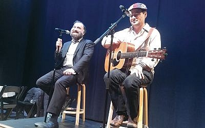 Noah Solomon (right) and Rabbi Naftali Citron sing chasidic melodies at the closing of a conference on Kabbalah at the Marlene Meyerson JCC in Manhattan on Sunday, January 27. (Ben Sales)