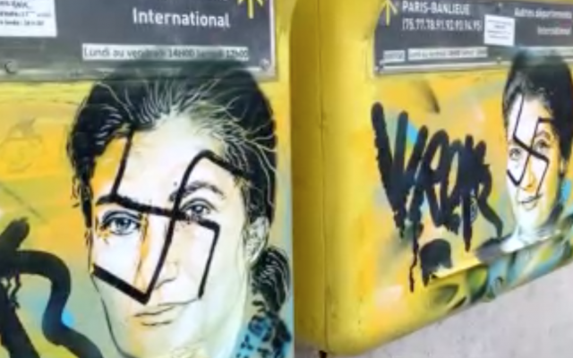 Swastikas were painted on images of Simone Veil, a former Jewish lawmaker, on the mailboxes of a Paris town hall. (Screenshot from Le Parisien)