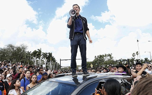 Marjory Stoneman High School student Cameron Kasky addresses area students at a rally at the school after participating in a countywide school walkout in Parkland, Fla., Feb. 21, 2018. (Rhona Wise/AFP/Getty Images)