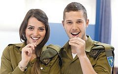 Israel Defense Forces soldiers swab their cheeks to provide samples for the Ezer Mizion Bone Marrow Registry.