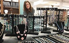 Rebecca Iovino of Teaneck was a practicing architect who had a stroke when she was 37. Now, as a member of the Adler Center, she runs the jewelry classes and creates one-of-a-kind pieces, using handmade glass beads, for the center's couture line.